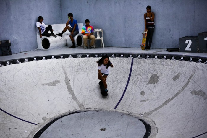 A female skater practices inside a bowl-shaped ramp as others watch and wait their turn inside the Backyard Skatepark in Sta. Rosa, Laguna. Photo by: Chris Quintana