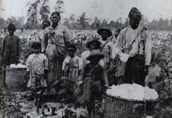 Family of slaves in Georgia, circa 1850. Wikimedia Commons.