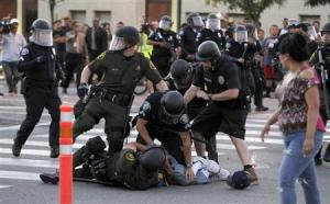 another political protester is beaten by cops