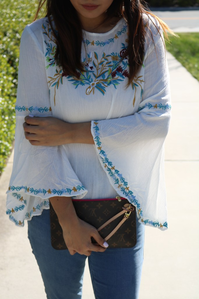details of a bell sleeved top