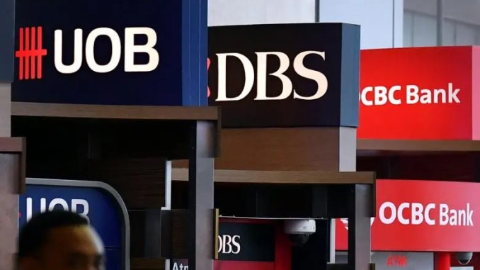 which singapore bank stock to buy