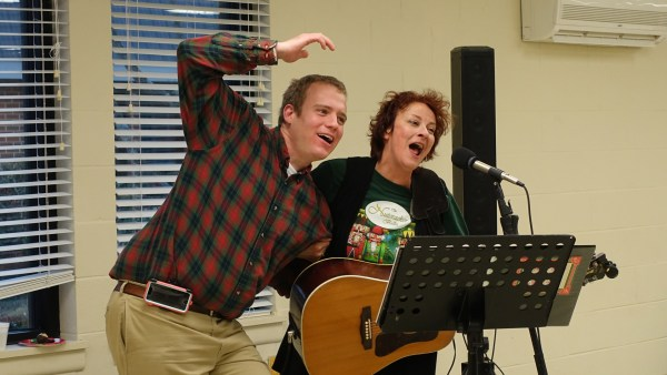 Robert and Leslie entertain the room with song and smiles at an Arc Community Celebration