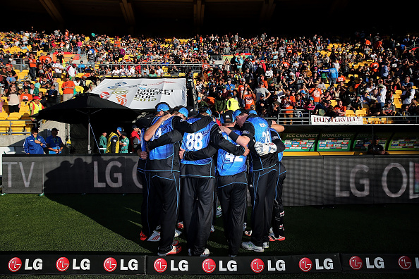 WELLINGTON, NEW ZEALAND - MARCH 21: Team New Zealand get into a team huddle before their innings during the 2015 ICC Cricket World Cup match between New Zealand and the West Indies at Wellington Regional Stadium on March 21, 2015 in Wellington, New Zealand.  (Photo by Anthony Au-Yeung-IDI/IDI via Getty Images)