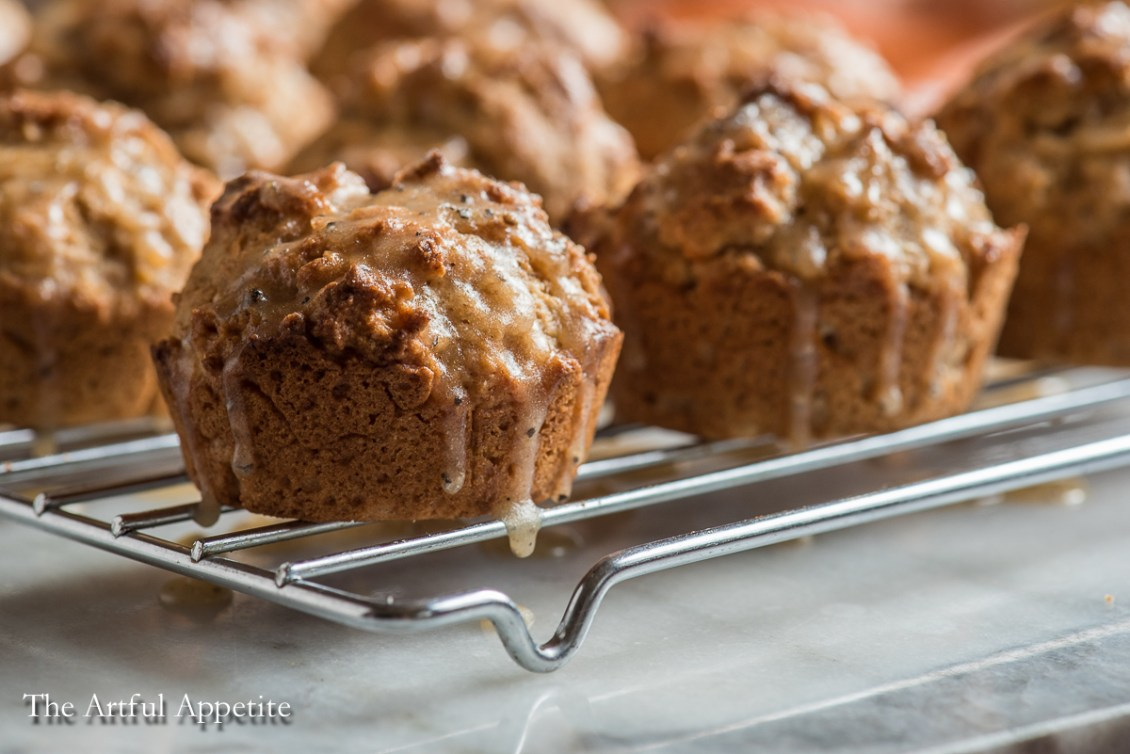 The perfect muffin for the cold winter months! These glazed cardamom grapefruit muffins are a delicious breakfast or snack. From The Artful Appetite