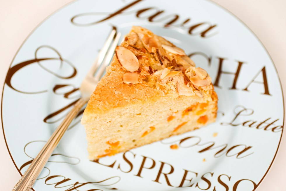 Apricot almond cake slice on plate