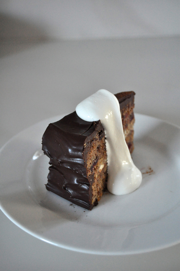 the artyologist- image of chocolate cranberry hazelnut cake with whipped cream for valentines