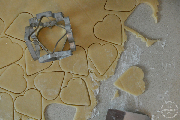 the artyologist- image of making heart shaped cookies with vintage cookie cutter for valentine's day party