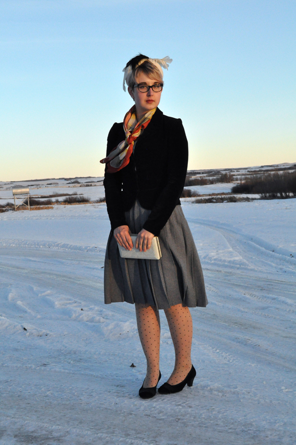 the artyologist - image of vintage 1940's style outfit with wool grey skirt, polka dot tights and feathered hat