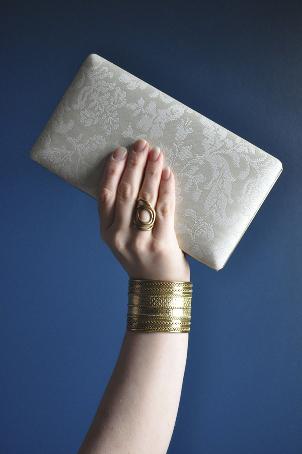 the artyologist- image of cream clutch in the style of vintage vogue 1939 cover