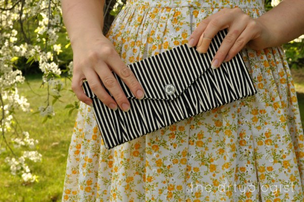 image of striped clutch the artyologist