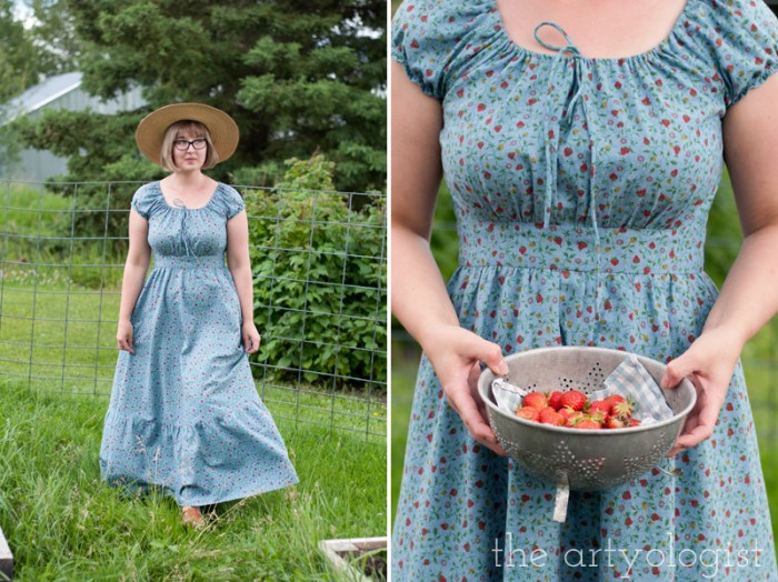 holding vintage colander of berries in the garden