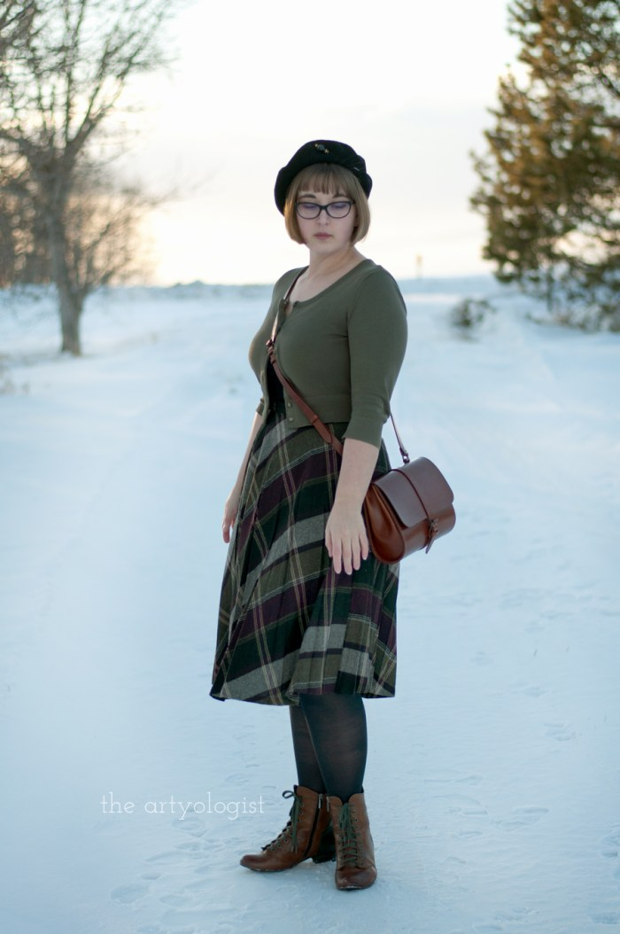lady wearing a vintage styled outfit on a snowy lane
