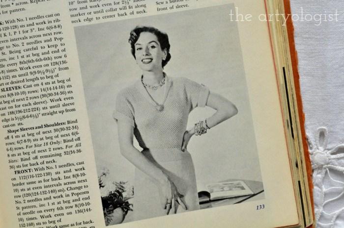 lady wearing a vintage short sleeved v neck sweater