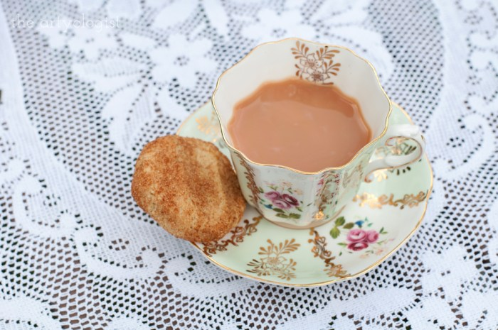 teacup with a cookie sitting on the saucer