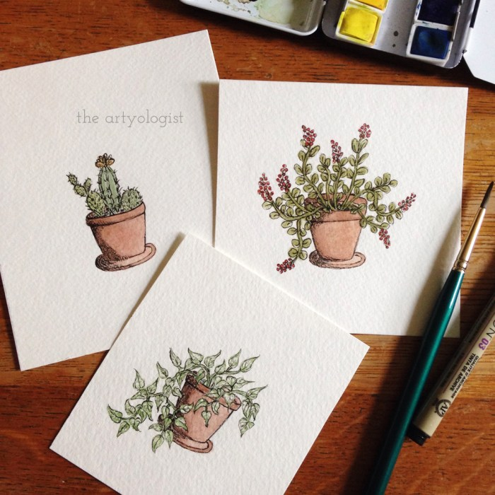 three tiny paintings of potted plants