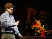 "Hunter Foster as Seymour Krelbourn and ""Audrey II"" (the puppet plant created by The Jim Henson Company)"