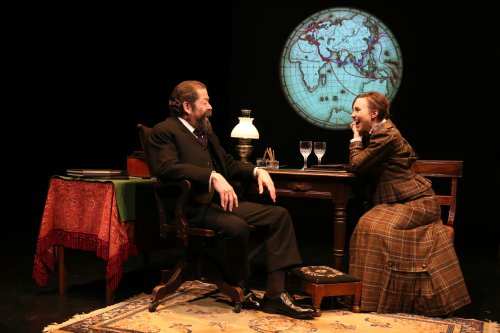 "Jonathan Hadary as Jules Verne and Samantha Hill as Nellie Bly in a scene from ""Jules Verne: From the Earth to the Moon"" (Photo credit: Joan Marcus)"