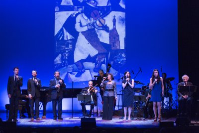 """The cast of 92Y's Lyrics & Lyricists Series: """"To Life! Celebrating 50 Years of 'Fiddler on the Roof'"""" with Marc Chagall's iconic painting that inspired the title (Photo credit: Richard Termine)"""