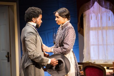 """Luke Forbes and Krystel Lucas in a scene from """"Couriers and Contrabands"""" (Photo credit: Al Foote III)"""
