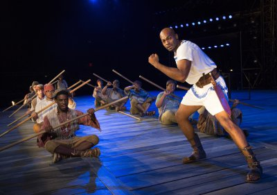 "Brandon Victor Dixon and company members in a scene from The Public Theater's free Public Works production of ""The Odyssey"" (Photo credit: Joan Marcus)"