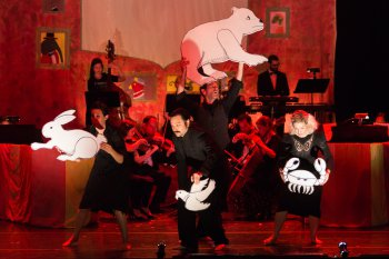 """Puppeteers Kristen Kammermeyer, Justin Perkins, Brendan McMahon and Rachael Shane in a scene from """"The Carnival of the Animals"""" at Miller Theatre (Photo credit: Karli Cadel)"""