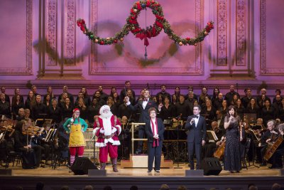 Stephanie J. Block, Brian D'Arcy James, Judith Clurman, Santa Claus and helper with maestro Steven Reineke and the New York Pops and Essential Voices USA (from left to right) (Photo credit: Richard Termine)