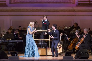 "Betsy Wolfe and Darren Criss with music director Steven Reineke at the podium as they appeared in The New York Pops presents ""42nd on 57th: Broadway Today"" (Photo credit: Richard Termine)"
