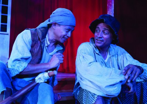 """Dinh James Doan and Jose Sanchez in a scene from Henri Brochet's """"St. Felix and His Potatoes,"""" included as part of """"Divine Comedy"""" (Photo credit: Michael Abrams Photography)"""