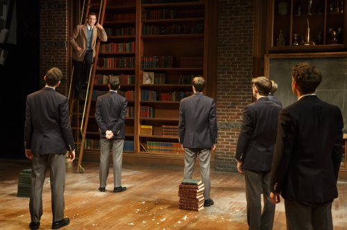 "Jason Sudeikis (on ladder) in a scene from ""Dead Poets Society"" (Photo credit: Joan Marcus)"