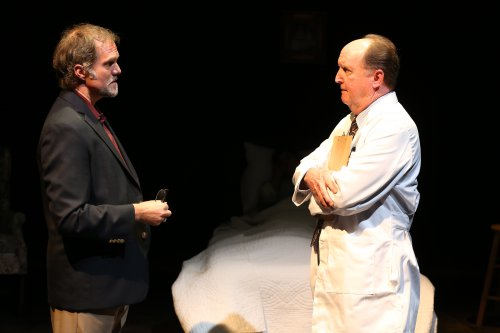 "Jeb Brown and John C. Vennema in a scene from ""Terms of Endearment"" (Photo credit: Carol Rosegg)"