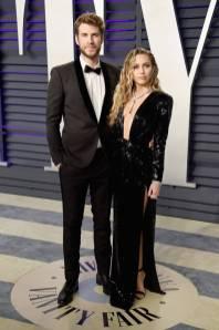 Miley Cyrus e Liam Hemsworth, entrambe in Saint Laurent, al Vanity Fair Oscar after party, LA