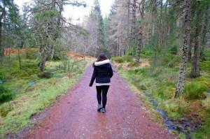 Girl walking in Scottish Highlands