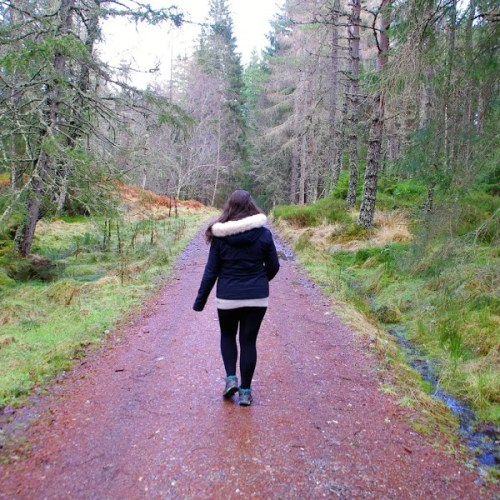 Girl walking in Scottish Highlands