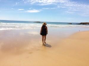 Girl walking on beach in Australia