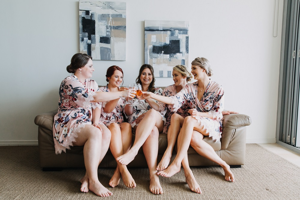 Bridal party in robes with champagne