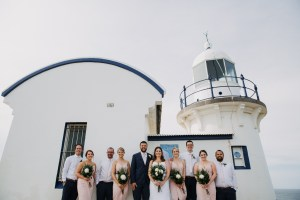 Bridal party standing in front of Tacking Point Lighthouse Port Macquarie