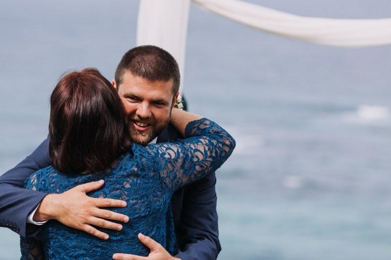 Groom hugging Mother of the bride