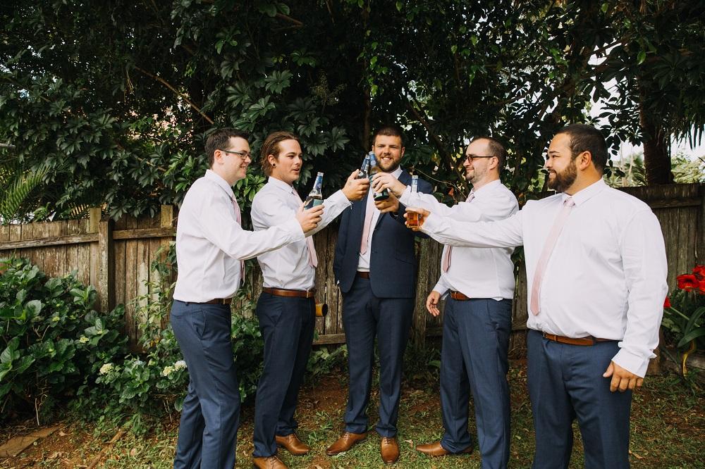 Groomsmen cheersing