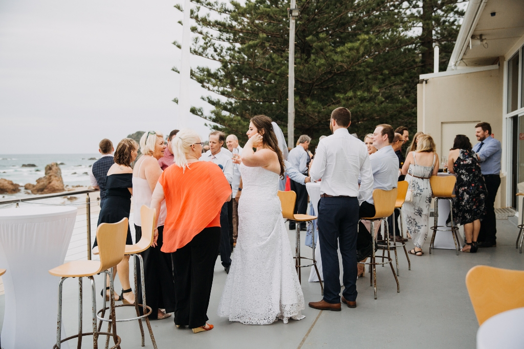 Wedding guests standing on balcony in Port Macquarie