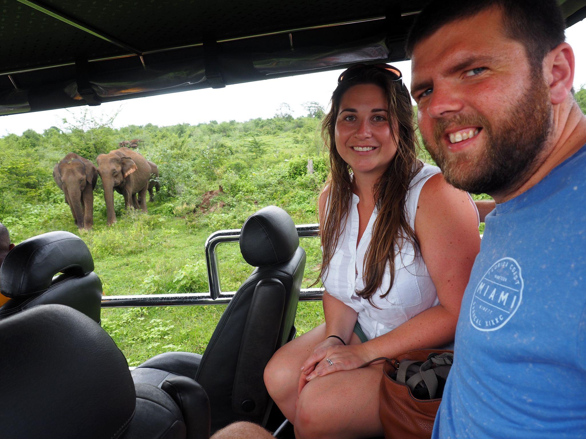 Couple with elephants Udawalwe National Park