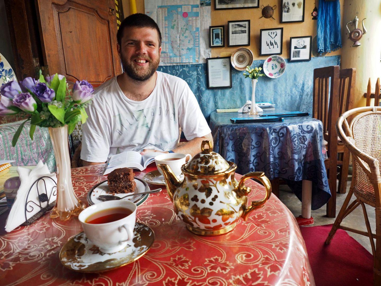 Boy in Royal Dutch Cafe Galle