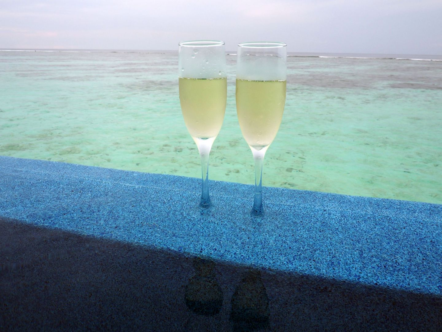 Champagne in Infinity Pool LUX Maldives