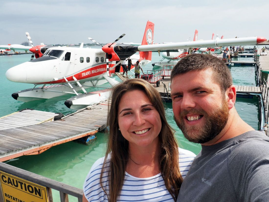 Couple in front of Seaplane in Maldives