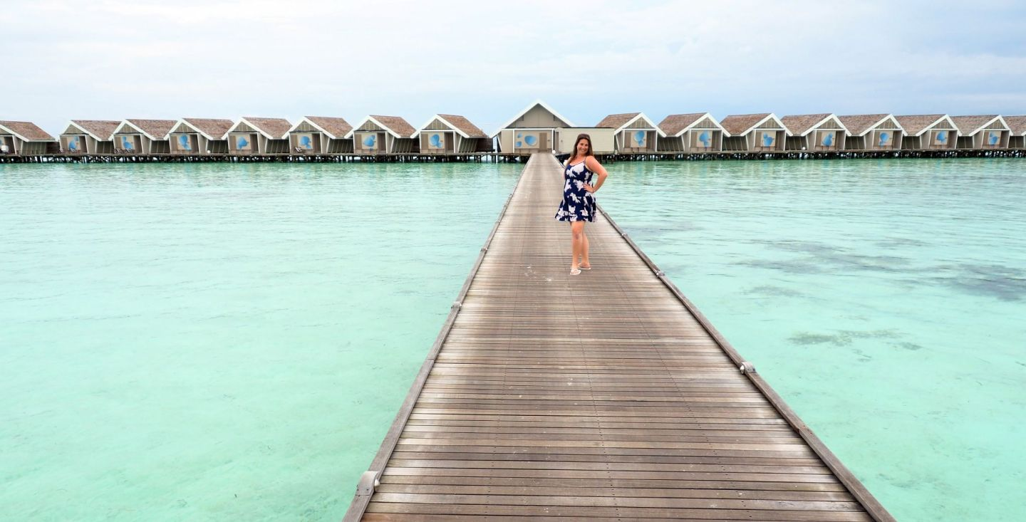 Girl on path to overwater bungalows LUX Maldives