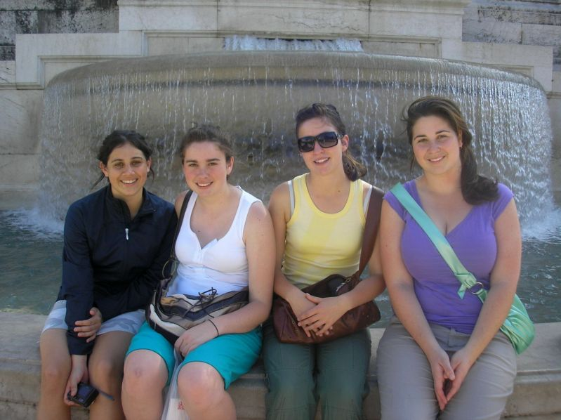 Girls in front of fountain in Rome
