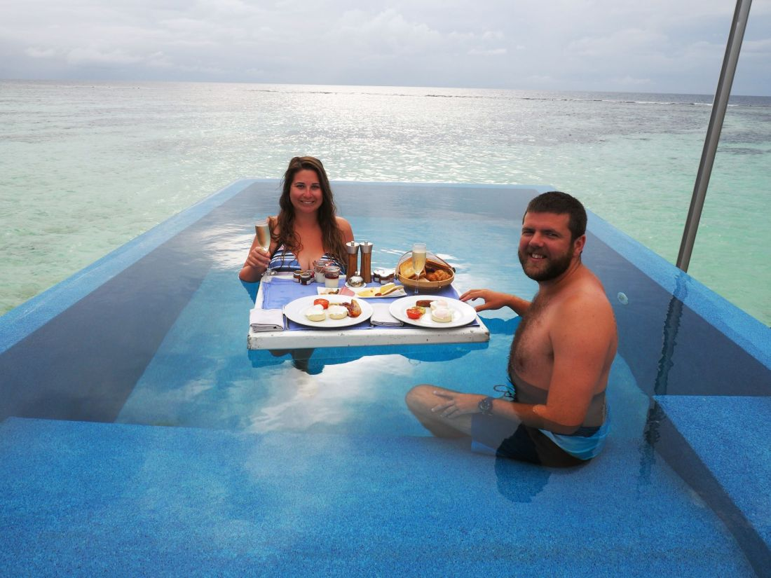 Couple having Floating Breakfast LUX South Ari Atoll