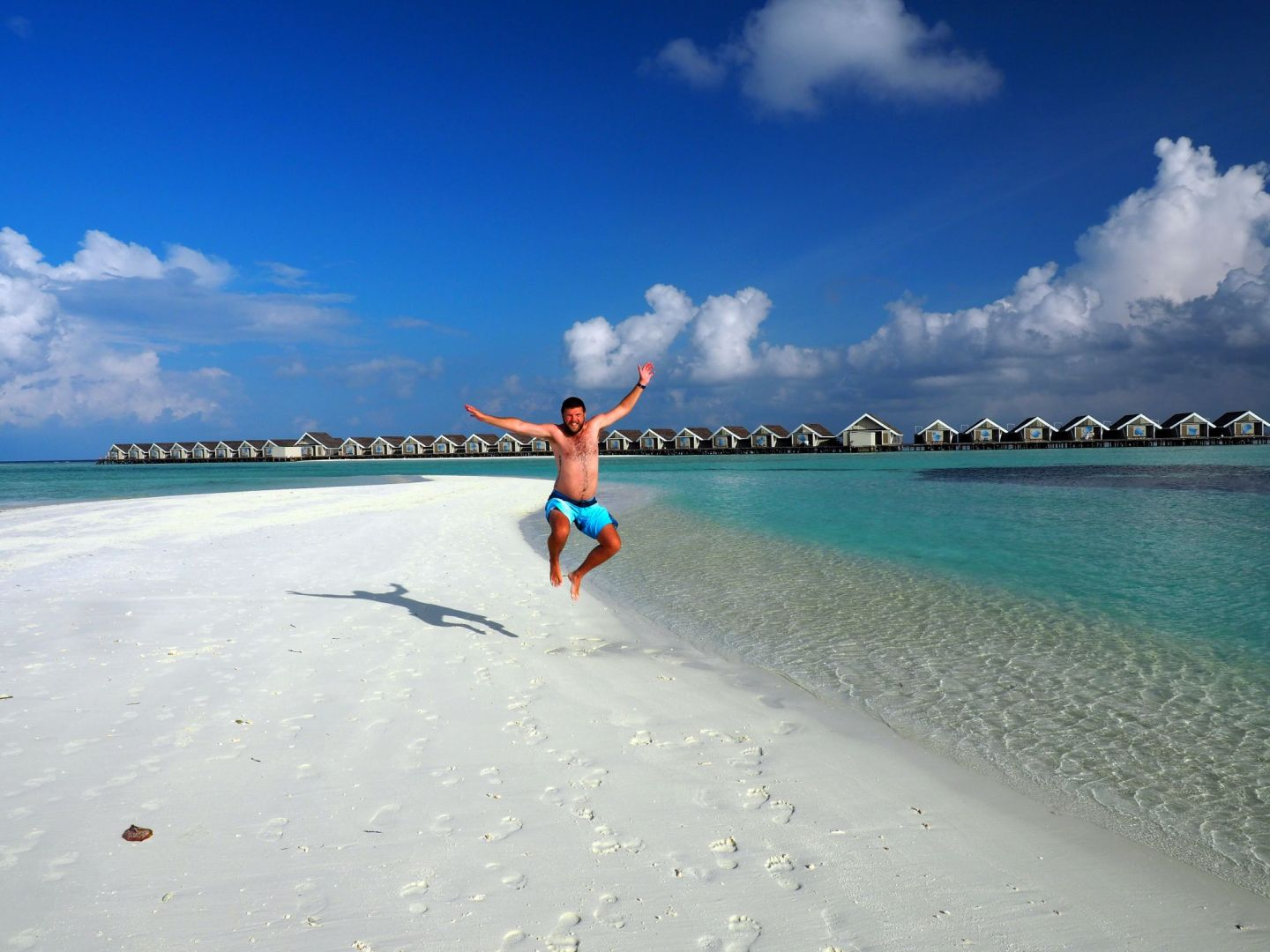 Dan jumping on sand bar in Maldives