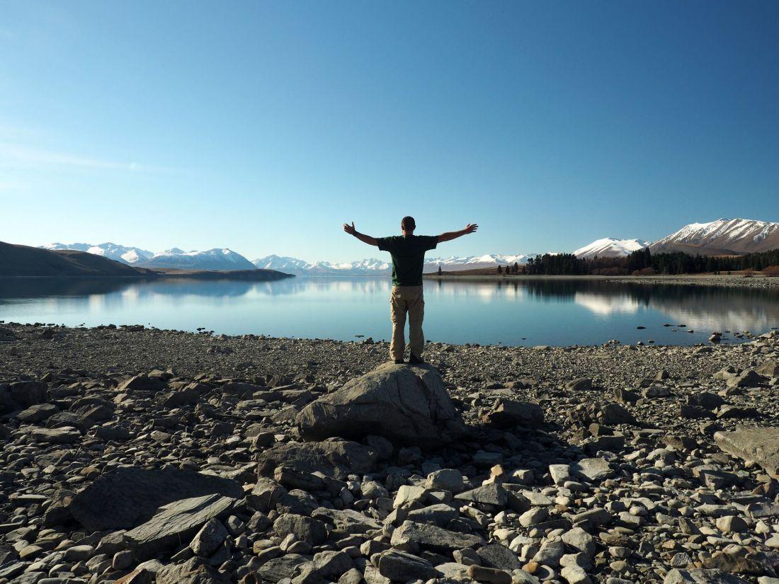 Dan arms stretched at Lake Tekapo