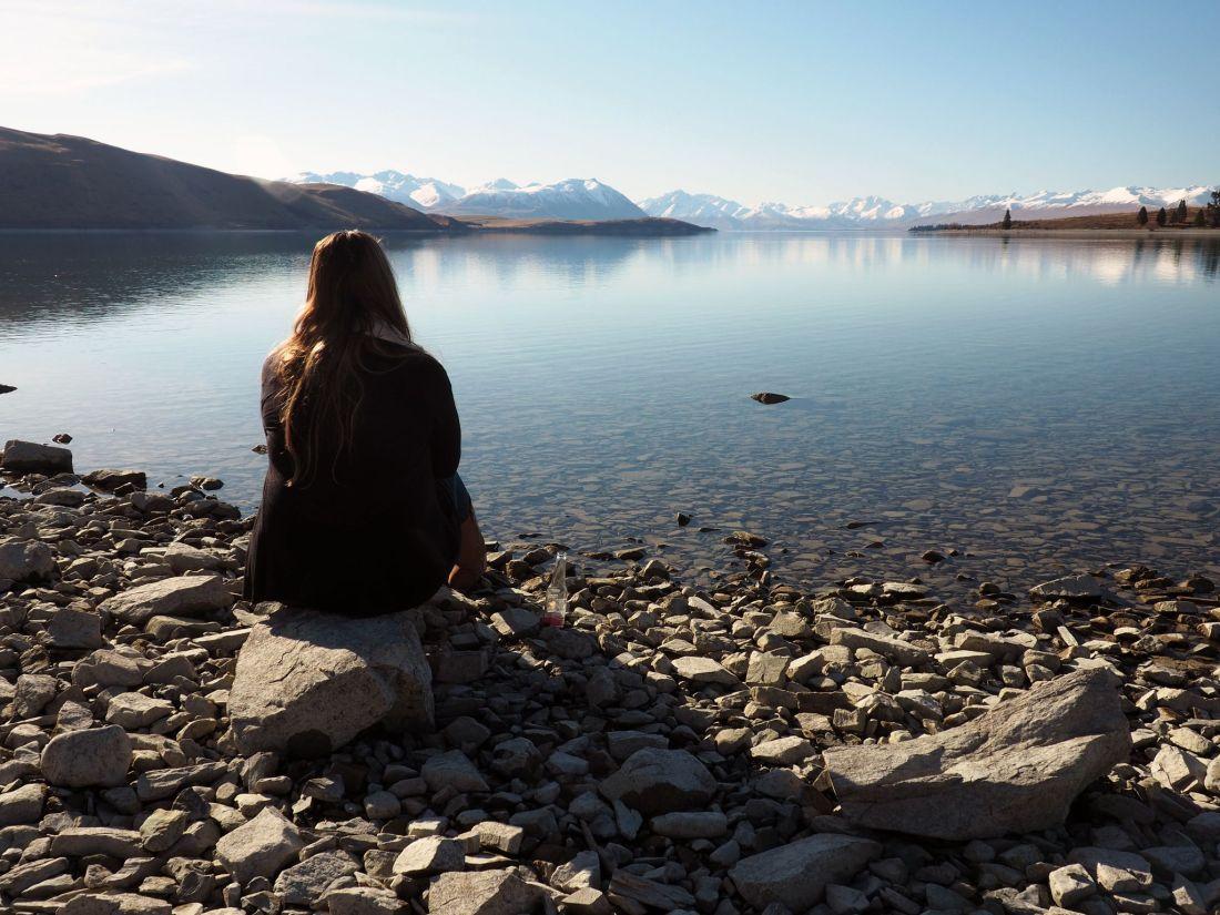 Simone sitting at Lake Tekapo