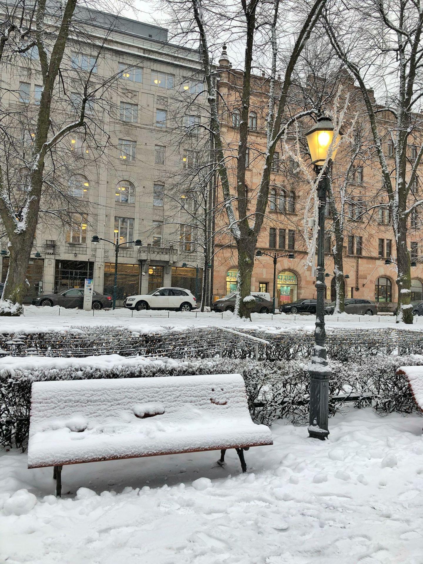 Snowy bench in Helsinki